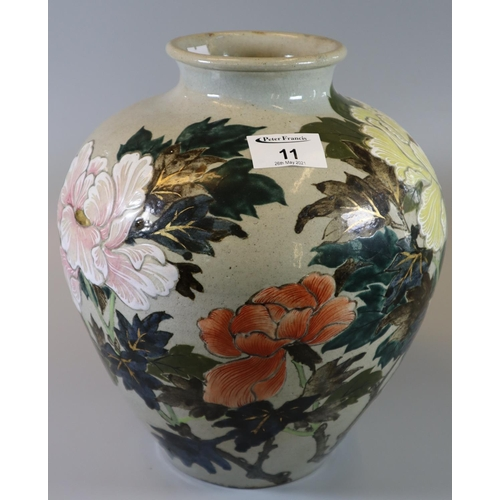 11 - Oriental design stoneware baluster form vase decorated with flowers and foliage. (B.P. 21% + VAT)