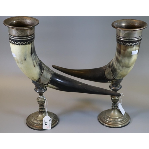 34 - Pair of 19th century silver plated and horn 'Cornucopia' pedestal vases. 35 cm high approx. (B.P. 21...