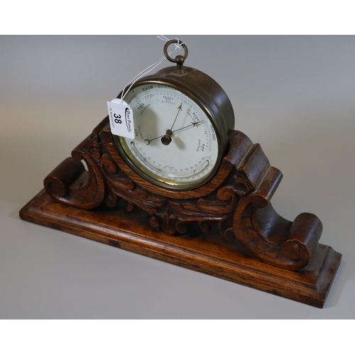 38 - 19th century brass drum shaped barometer with thermometer, unnamed, on a carved oak scrolled and fol...