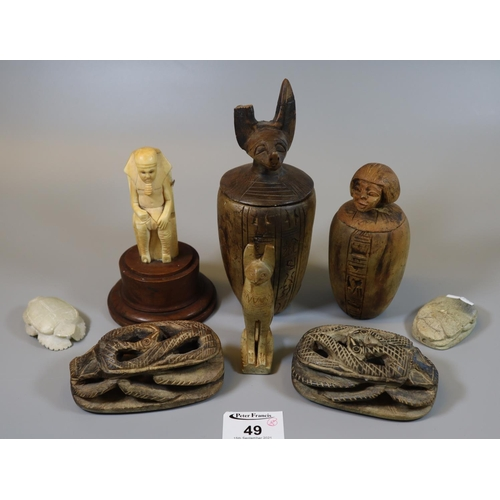 49 - Group of modern tourist type Egyptian style creatures and objects including scarab beetle, figures, ...