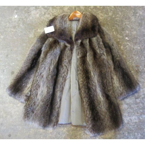 559 - A vintage raccoon fur jacket.  (B.P. 21% + VAT)