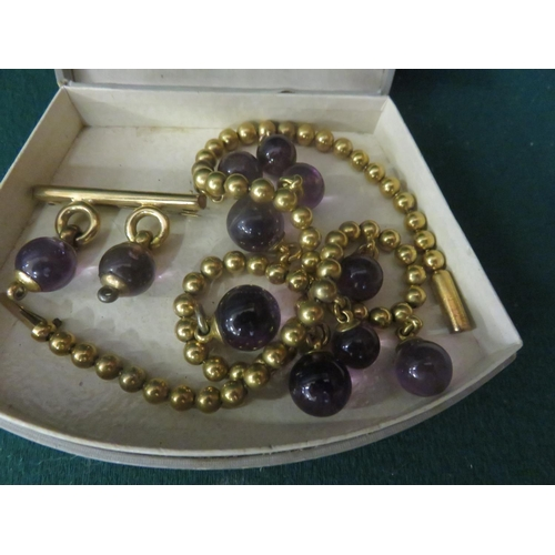 84 - Gilt Metal and Amethyst Style Ball Necklace and matching 9ct. Gold Brooch