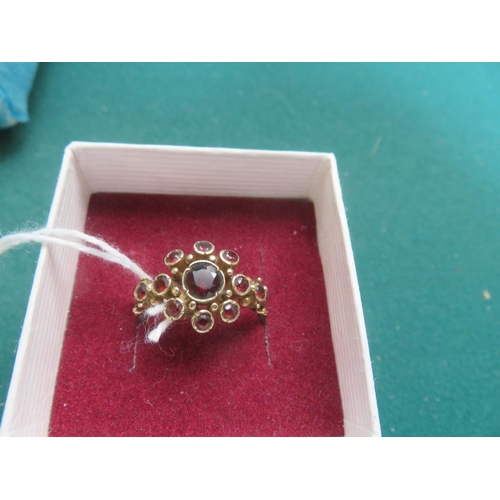59 - 9ct. Gold and Garnet Cluster Ring