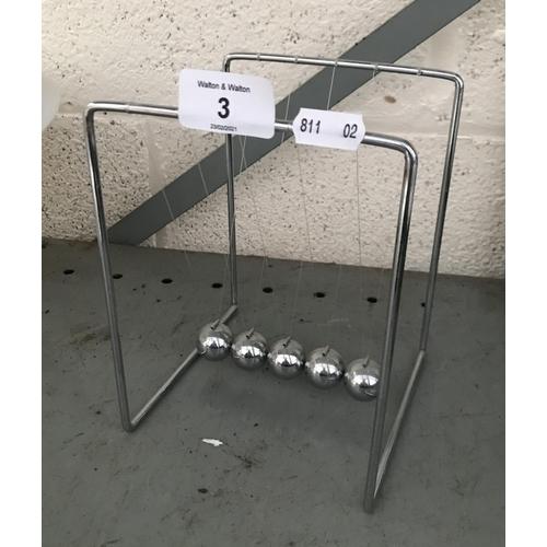 3 - A Newton's cradle
