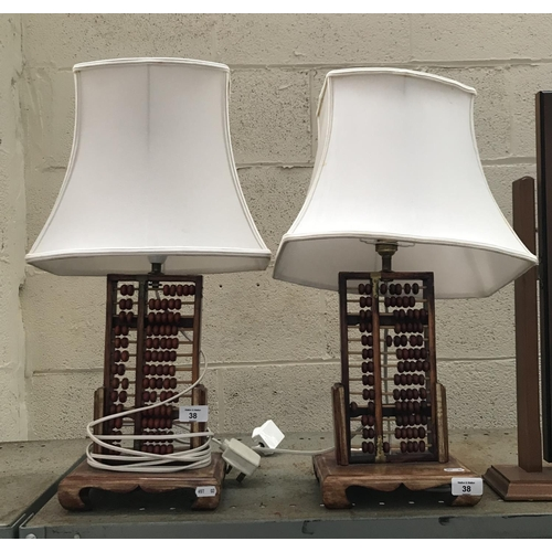 38 - Pair of Oriental abacus table lamps...