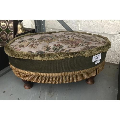 40 - Upholstered footstool...