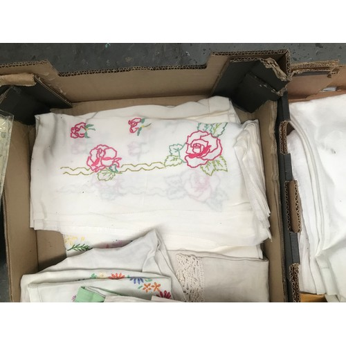 49 - 2 Boxes containing vintage table cloths and linen etc...