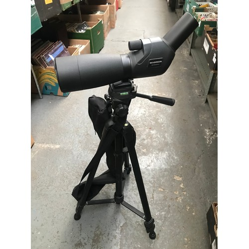 44 - A camera tripod and a mounted Maginon spotting scope