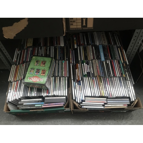 12 - 2 Boxes containing CDs