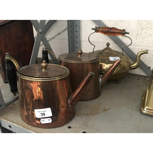 39 - 2 Copper teapots and a brass teapot