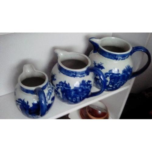 6 - A Set Of Three Victoria Ware Iron Stone Blue & White Jugs...