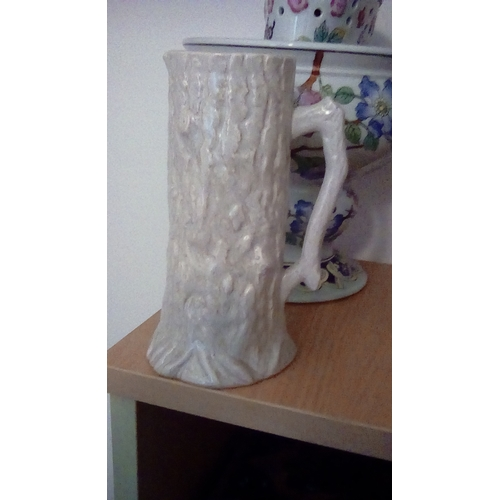 8 - A Mid Century German Pottery Tree Trunk Tankard In White....