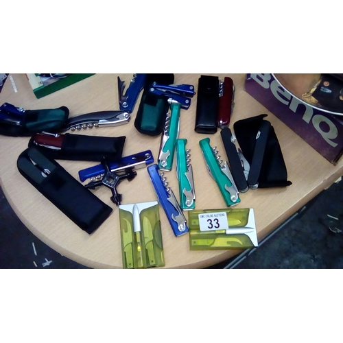 33 - Collection of folding tools, penknives, bottle openers Swiss style Etc 10...