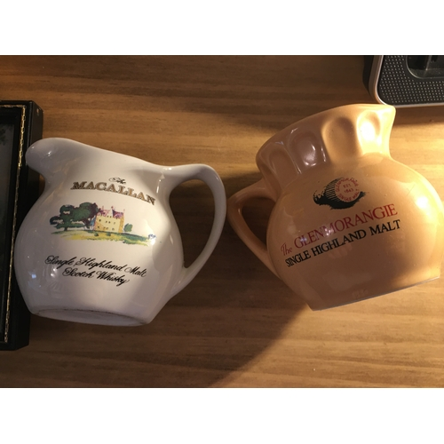 54 - TWO VINTAGE SMALL WHISKY WATER JUGS INCLUDING MACALLAN AND GLENMORANGIE