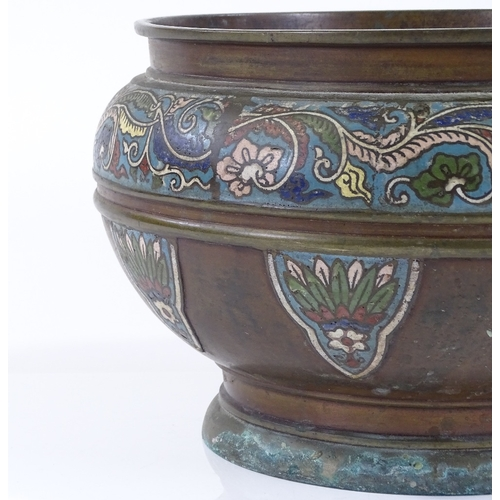 10 - A Chinese bronze and champleve enamel decorated jardiniere, circa 1900, rim diameter 26cm, height 19...