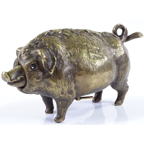 19 - An unusual brass mechanical butcher's shop counter bell, in the form of a pig, length 16cm, mechanis...
