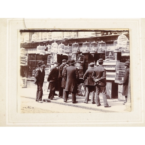 31 - A small album of original late 19th century photographs depicting London street scenes, album size 1...