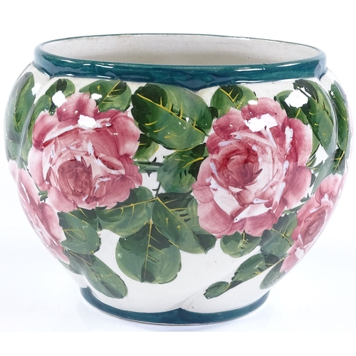 55 - A Wemyss Pottery jardiniere with hand painted rose decoration, impressed and painted marks under bas...