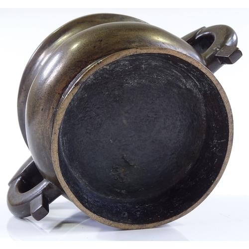 7 - A Chinese cast-bronze 2-handled incense burner with engraved geometric designs, rim diameter 12cm, h...