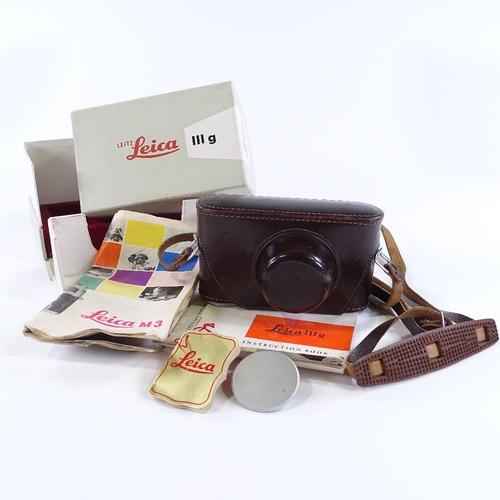 2 - A Leica 111G camera, circa 1958, serial no. 968523, with original Leica lens, leather case, original...
