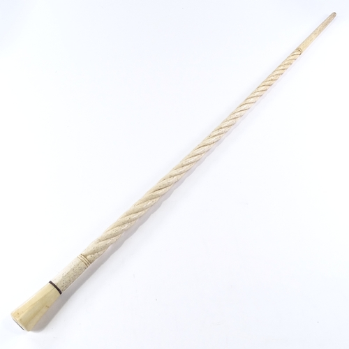 6 - A 19th century marine ivory walking stick with spiral twist design, tapered octagonal ivory handle a...