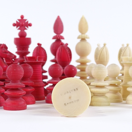 5 - A 19th century red and white stained ivory chess set, white King stamped Jaques London, King height ...