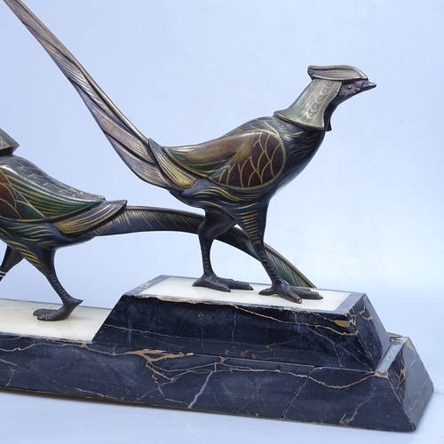 1 - A pair of patinated bronze Egyptian revival style birds on coloured marble plinths, length 47cm over...