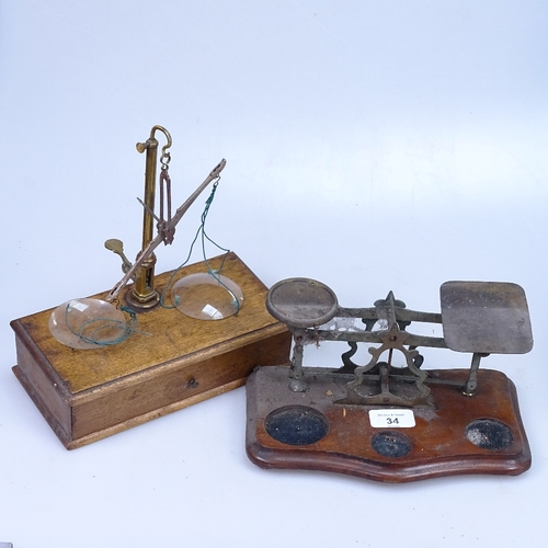 34 - An oak scale with weights in drawer, and a small postal scale, length 24cm...