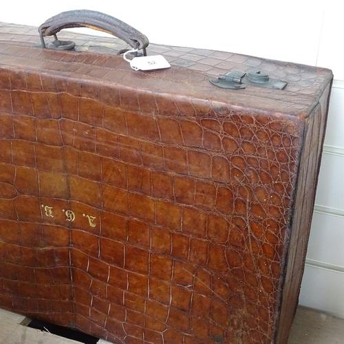 52 - A crocodile skin suitcase, monogrammed AGB length 60cm...