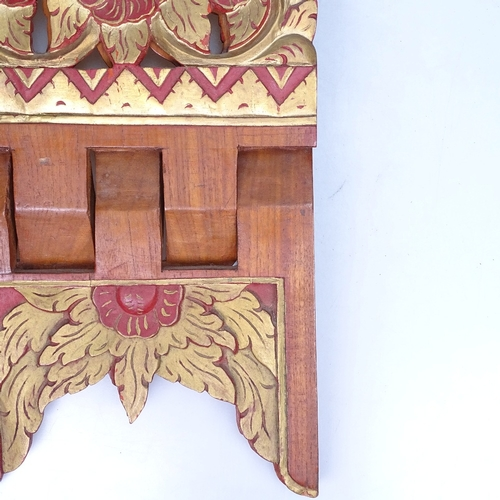 7 - A carved and gilded teak folding Koran stand, height 46cm...