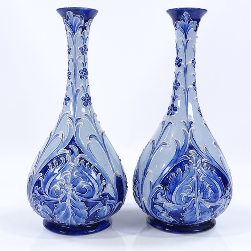 15 - A pair of James Macintyre Burslem Florian Ware narrow-necked vases, with relief floral decoration, r...