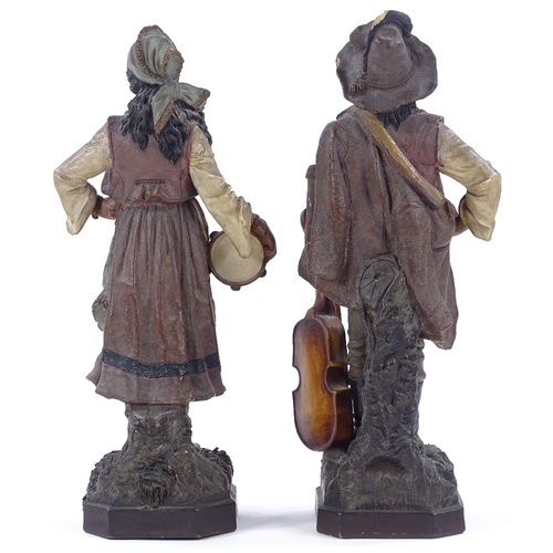 28 - A pair of 19th century Continental terracotta figures, with painted decoration, impressed maker's ma...