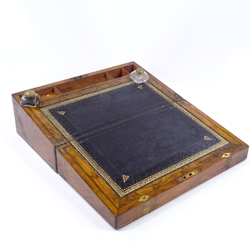 55 - A Victorian brass-bound walnut writing slope, with fitted interior and original inkwells, width 45cm...