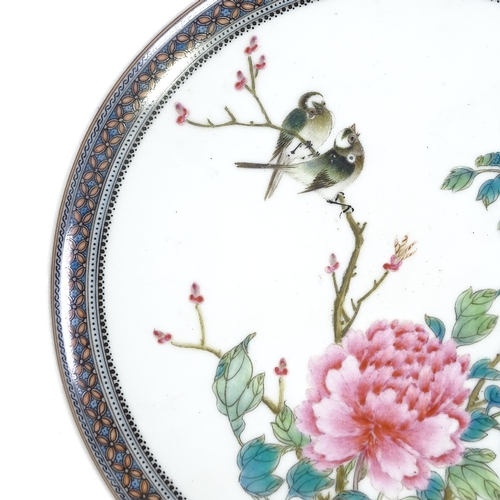 10 - A Chinese Republic Period porcelain plate, hand painted enamel exotic birds and flowers in painted g...