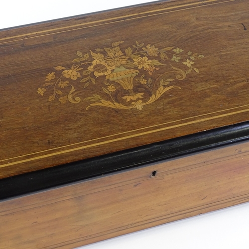 15 - A 19th century Swiss rosewood and marquetry inlaid musical box, playing eight aires on a 21cm cylind...