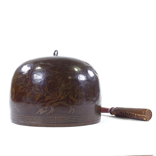 16 - A Japanese bronze dome-shaped temple gong, with inlaid metal mountain landscape, suspension chain an...