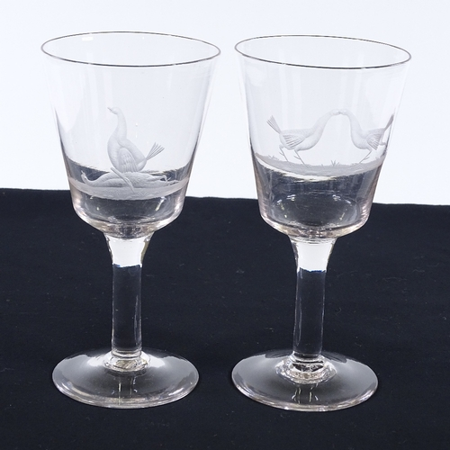 28 - A pair of 19th century ale glasses, with wheel-cut fight cock designs, height 20cm, diameter 10cm...