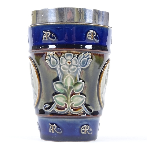 33 - An Edward VII and Queen Alexandra Doulton Lambeth commemorative beaker with hallmarked silver rim, h...