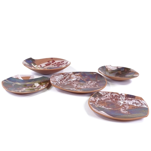 39 - Pauline Monkcom, 5 terracotta-shaped dishes with printed map designs of Ross-on-Wye, largest length ...