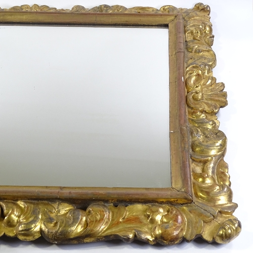 4 - A 19th century Florentine carved acanthus giltwood-framed wall mirror, overall dimensions 98cm x 83c...