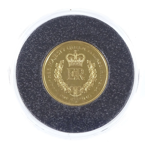 52 - A 2015 proof gold £1 coin by Harrington & Byrne...