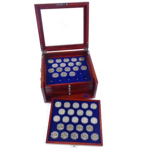 54 - The John F Kennedy uncirculated US Half Dollar collection in wooden cabinet...