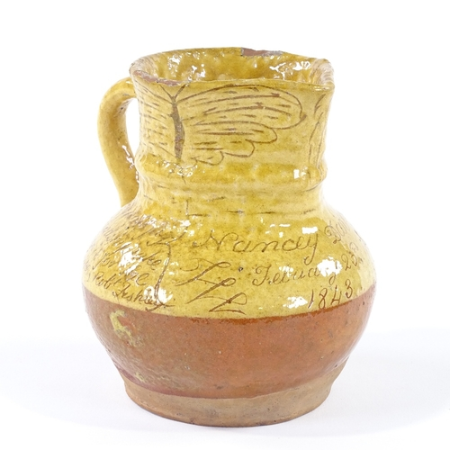 6 - Robert Fishley (1808 - 1887), Fremington Pottery, ochre glaze slip decorated earthenware jug, inscri...