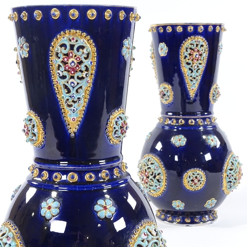 7 - A pair of Hungarian blue glaze pottery vases, circa 1900, in the manner of Zsolnay, with pierced and...