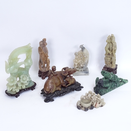 10 - A collection of various Oriental soapstone and jadeite carvings, including water buffalo, and birds-...