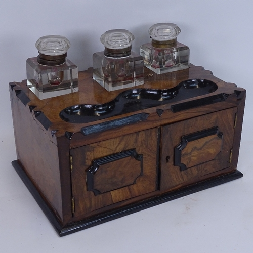 11 - A Victorian walnut table-top writing cabinet, with 3 large fitted cut-glass inkwells, pen tray and c...