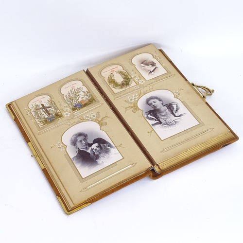 13 - A Victorian felt-bound family photograph album, gilt-metal mounts and mostly full, album length 35cm...