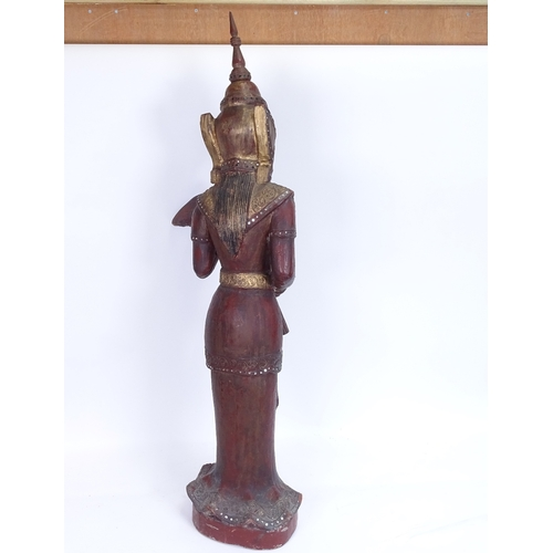 16 - A large Burmese carved lacquered and gilded wood Nat figure on plinth, overall height 93cm...