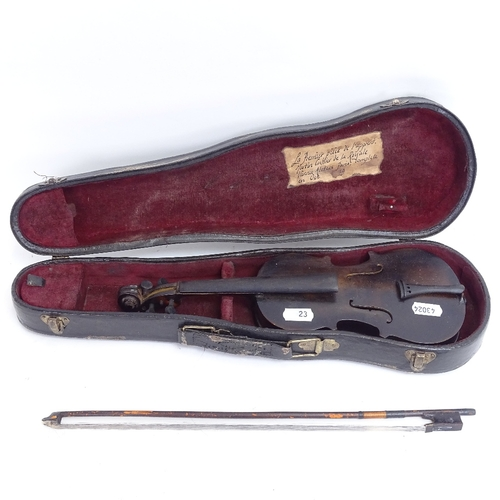 23 - A miniature cased violin and bow, inner label to Martin Cultier of The Royal Vienna Aletees and date...