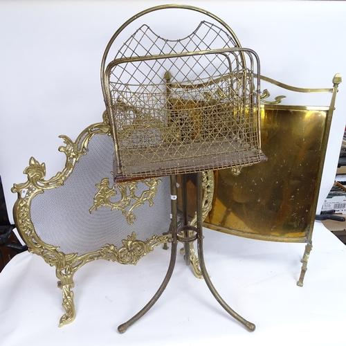 30 - 2 brass fire screens, and a brass-framed magazine rack, largest screen height 68cm (3)...
